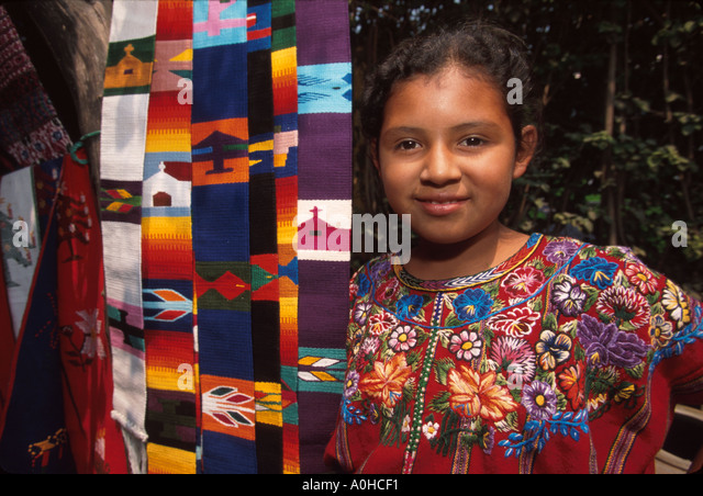 Guatemala La Antigua colonial capitol until earthquake Cakchiquel Indigenous girl handicrafts - Stock Image