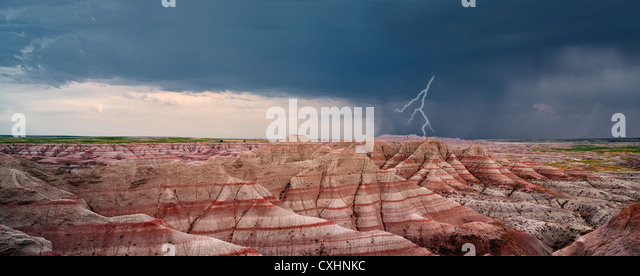 Panoramic view of colorfull rock formations with thunderstorm and lightning.. Badlands National Park, South Dakota. - Stock Image