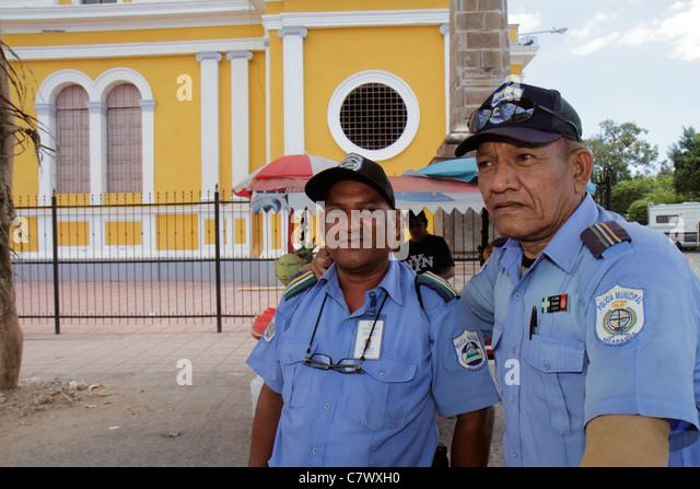 Nicaragua Granada Granada Square Avenida Guzman Central Plaza historic district Hispanic man National Police uniform - Stock Image