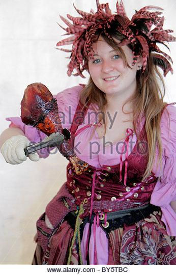 Deerfield Beach Florida Quiet Waters Park Florida Renaissance Festival costume woman turkey leg food vendor - Stock Image