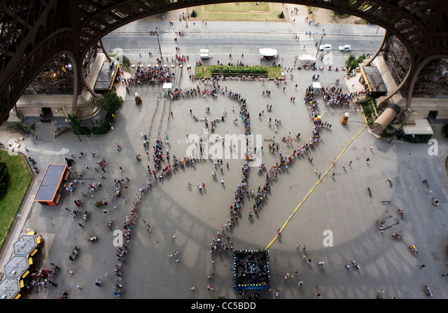 View from Eiffel Tower, of visitors queue up to enter. Paris, France. - Stock Image