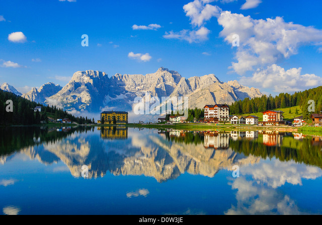 Italy, Europe, travel, Dolomite, Alps, Missurina, Lake, pedalo, clouds, colourful, mountains, reflection, south - Stock Image