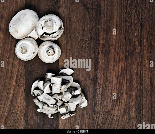 Mushrooms on a Chopping Board - Stock Image