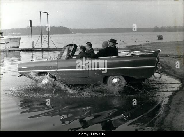 Mar. 03, 1961 - Swimming car makes maiden trip.: A maiden trip in which water sport fans were just as interested - Stock Image