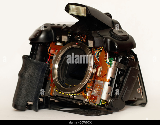 A DSLR camera in pieces. - Stock Image