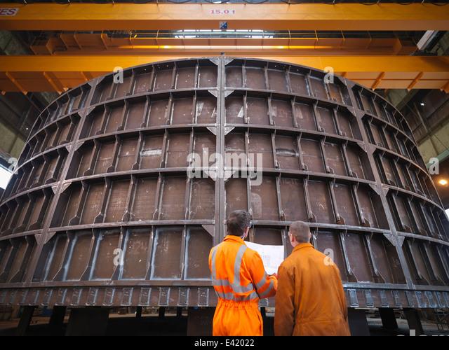 Engineers inspecting marine fabrication - Stock Image