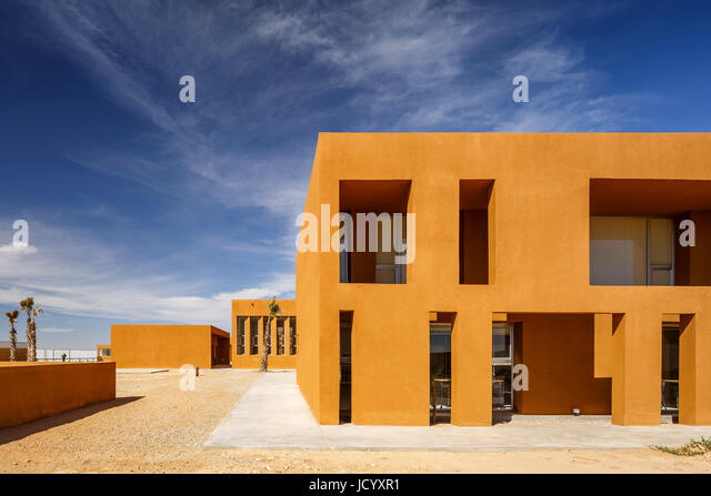 Facade detail and landscaping. Laayoune Technology School, Laayoune, Morocco. Architect: Saad El Kabbaj, Driss Kettani, - Stock-Bilder