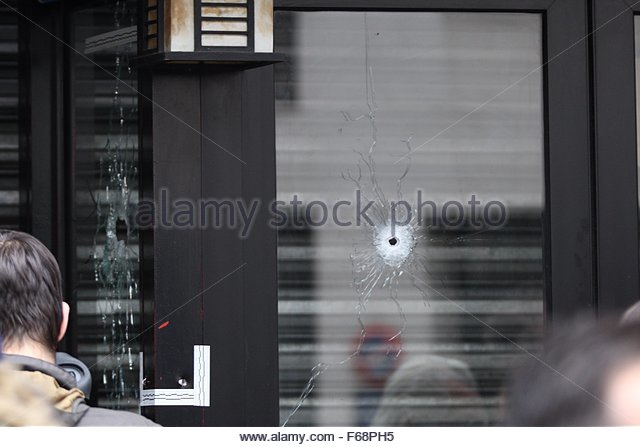 Paris, France. 14th November, 2015. Bullet holes are seen on the windows of the cafe 'La Belle Equipe' in - Stock Image
