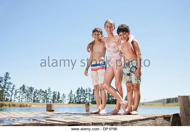 Portrait of kids on dock - Stock Image
