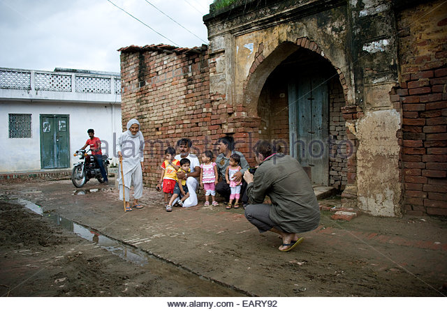 A geneticist collects data from twins in a village. - Stock Image