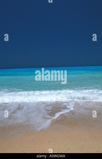 Tropics empty tropical beach bright turquoise water - Stock Image
