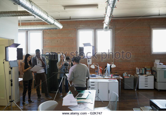 Creative business people filming tutorial - Stock Image