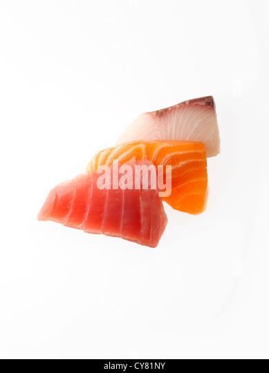 Three Slices of Raw Tuna, Salmon and Yellowtail for Sashimi - Stock Image