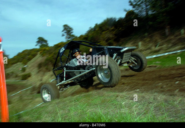 Janes Moncur seen here competing in the buggy race section of The Drambuie Pursuit Adventure Race - Stock Image