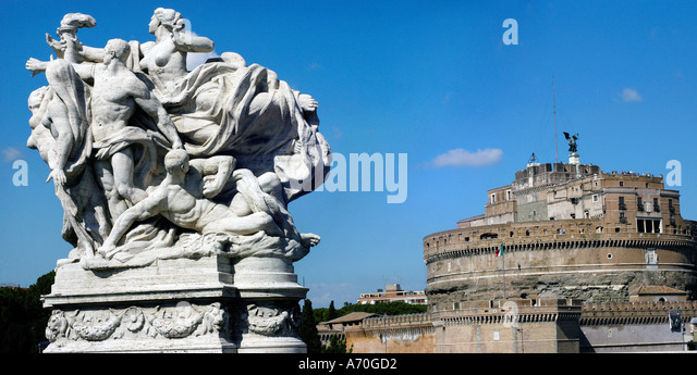 A statue depicting victory found on Ponte Vittorio Emanuele II with Castel Sant Angelo Rome Italy - Stock Image