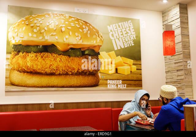 Mumbai India Asian Lower Parel High Street Phoenix mall inside restaurant Burger King fast food promotion Paneer - Stock Image