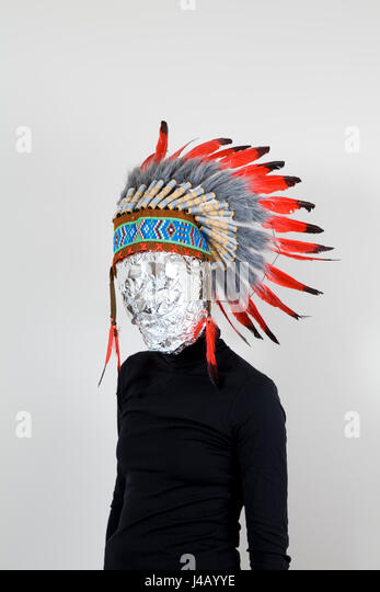 Head coated with aluminum foil and headdress american indian native - Stock Image