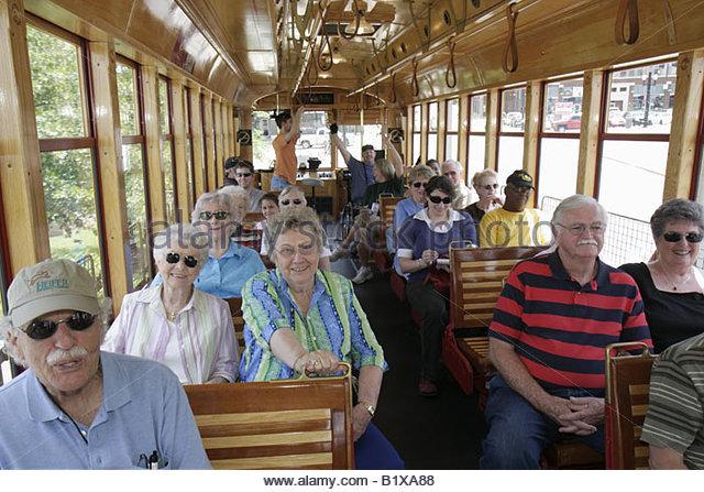Arkansas Little Rock River Rail Electric Streetcar man men woman women active senior tour heritage trolley replica - Stock Image