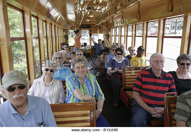 Little Rock Arkansas River Rail Electric Streetcar man men woman women active senior tour heritage trolley replica - Stock Image