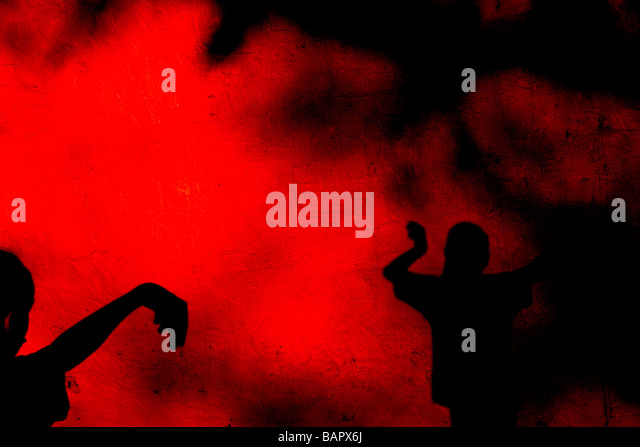 Children casting shadows on a rough red wall - Stock-Bilder