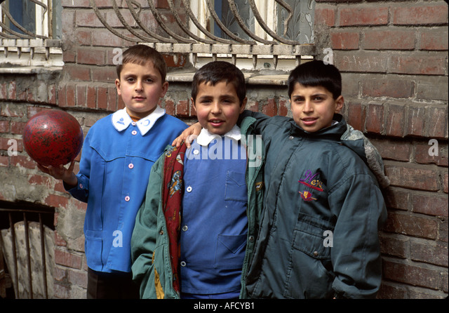 Turkey Europe Asia Istanbul Balat Old Jewish Quarter Muslim boys friends ball - Stock Image