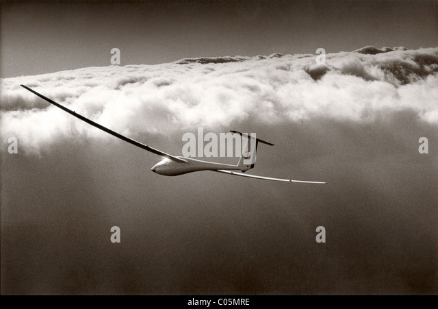 Glider above the clouds - Stock Image