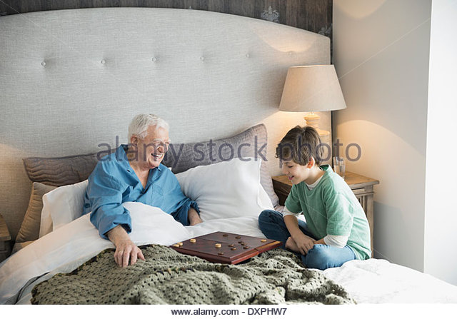 Grandfather and grandson checkers - Stock Image
