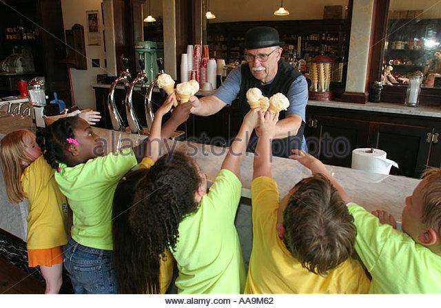 Alabama Dothan Landmark Park historic drug store soda counter ice cream cones children - Stock Image
