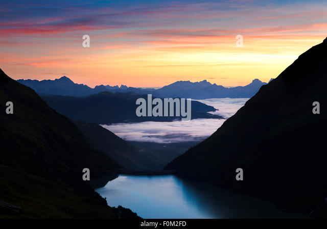 Wasserfallboden reservoir at sunrise, Kaprun, Austria - Stock Image