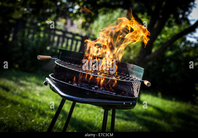 Super flames on the grill - Stock Image