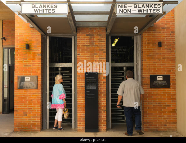 Outside the entrance to the Apartheid Museum showing the old whites and non-whites signs from apartheid era, Johannesburg - Stock Image