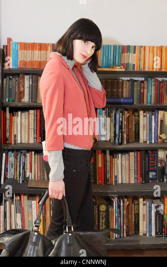 Woman carrying large purse - Stock Image