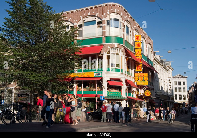 Amsterdam chinese restaurant street scene people - Stock Image