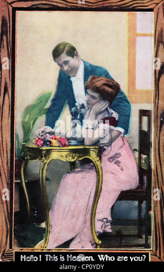 Hello, this is heaven. Who are you? Vintage post card showing woman on phone while man looks on - Stock Image