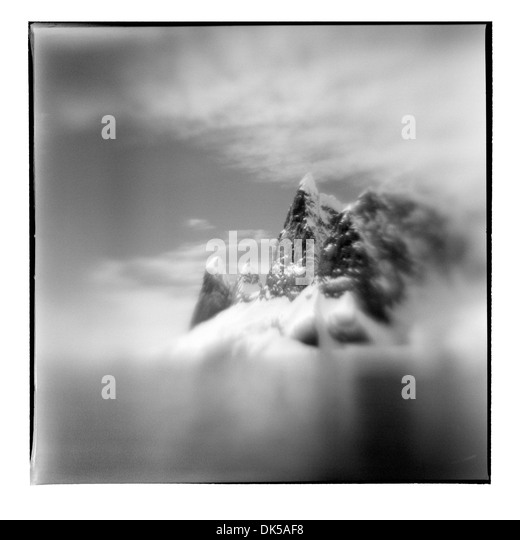 Antarctica, Blurred black and white image of mountain peaks near Cape Renard along Lemaire Channel on sunny summer - Stock Image