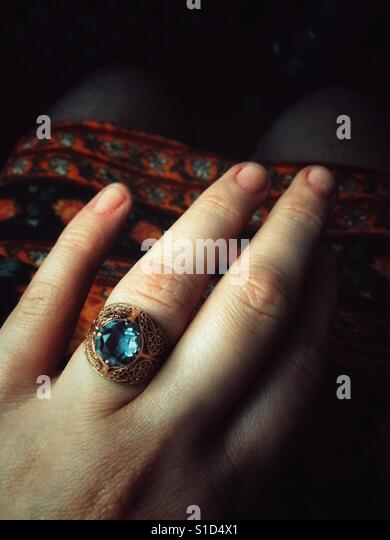 Woman hand wearing an engagement ring - Stock Image