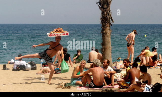 spain Barcelona beach doghnut seller posing people - Stock Image