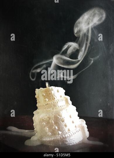 An extinguished wedding cake candle. - Stock Image