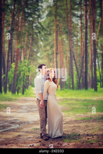 Gentle couple on romantic date, wedding day ceremony in the forest, tender feelings, enjoying spring nature and - Stock Image
