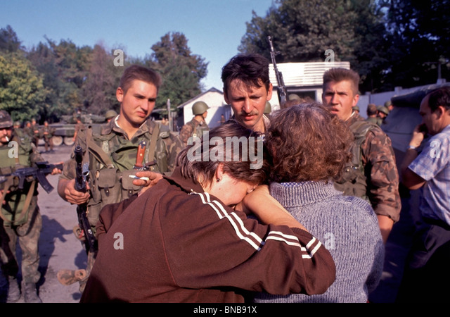 Russian women plead with a Russian Army officer to be evacuated from Kulob, Tajikistan in 1992 during the Tajik - Stock Image