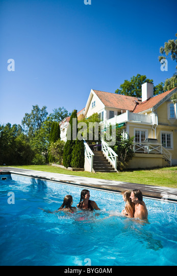 Family four in swimming pool stock photos family four in for Family swimming pool