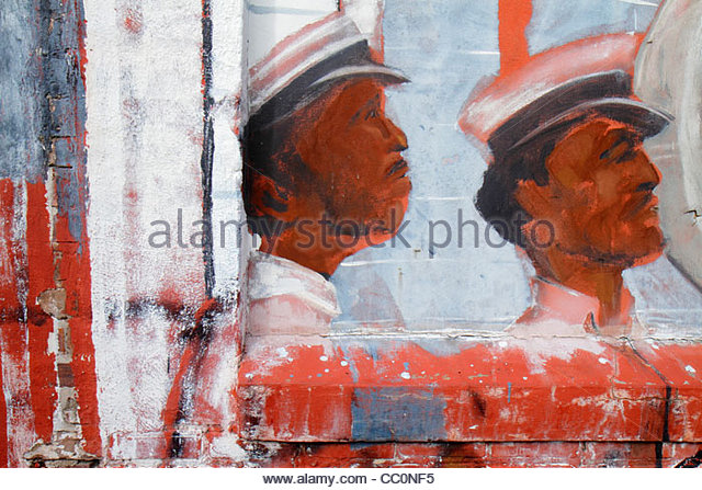 Louisiana New Orleans Warehouse District wall mural painting Black male hat profile detail art - Stock Image