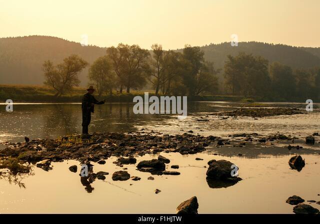 Mid adult man fishing in lake, Sarsy village, Sverdlovsk region, Russia - Stock Image