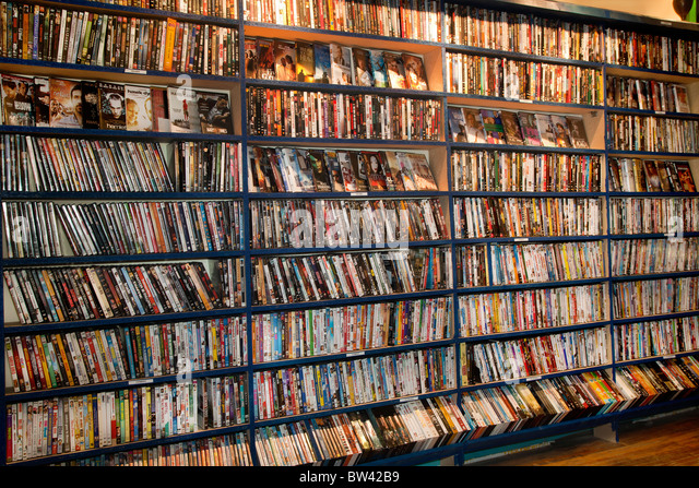 Full frame of rows of DVDs in video store or library - Stock Image