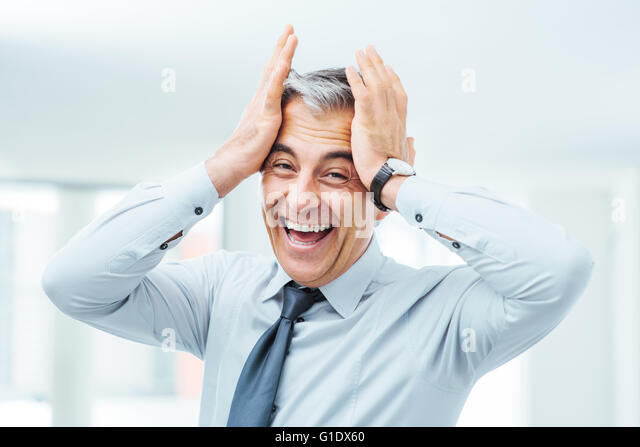 Cheerful careless businessman laughing and touching his forehead - Stock-Bilder