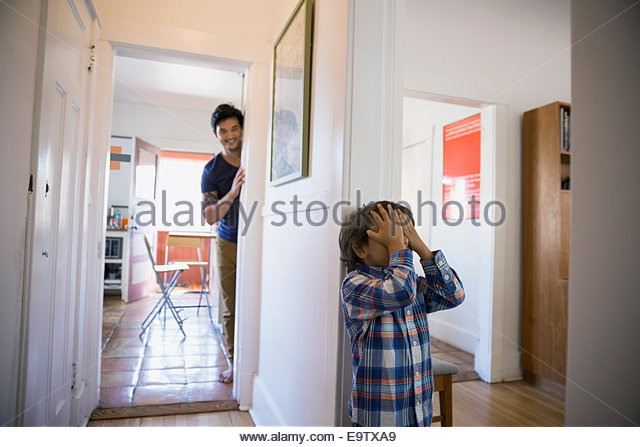 Father and son playing hide-and-seek - Stock Image