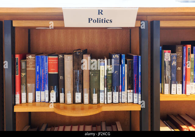 Politics books in a library on library shelves, England UK - Stock Image