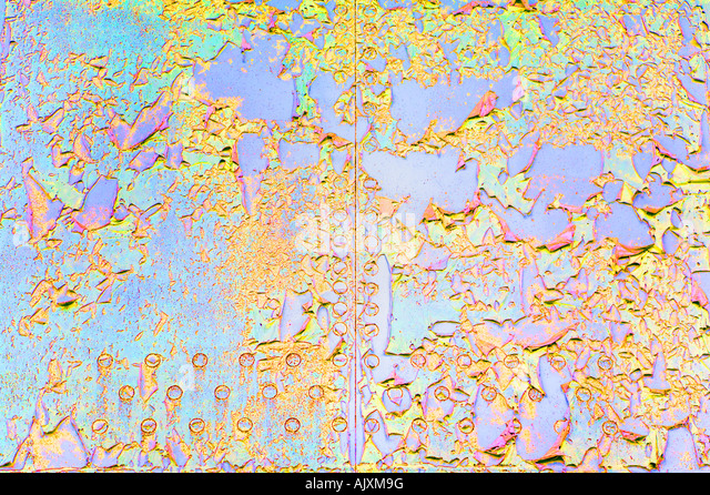 colourful peeling paint on steel panel - Stock Image
