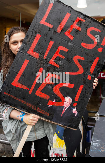 Young woman holding up a Lies poster Anti-Brexit protest in Central London - Stock Image