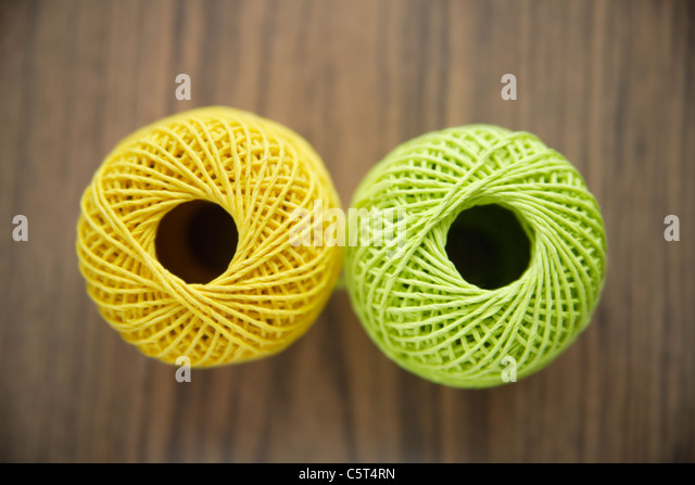 Germany, Close up of two balls of cord - Stock Image